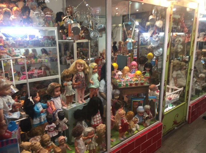Dolls in one of San Telmo Mercado's quaint shops